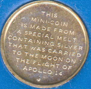 This coin contains metal flown on Apollo 14 Moon landing mission.